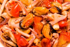 Seafood. Octopus mussels clams shrimp with cherry tomatoes and olive oil Royalty Free Stock Photos