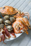 Seafood. Shrimps mussels squid and crab a great taste of seafood on dish Stock Photo