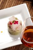 Seafood. Raw fish on plate decorated with glass of wine Royalty Free Stock Images