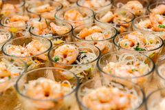 Seafood appetizers in small glasses stock photography