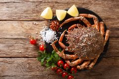 Seafood background: raw edible spider crab with ingredients close-up on a wooden table. Horizontal top view. Seafood background: raw edible spider crab with royalty free stock images