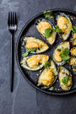 Seafood. Baked mussels with cheese and lemon in shells Royalty Free Stock Images