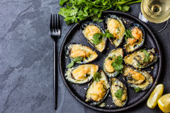 Seafood. Baked mussels with cheese and lemon in shells Royalty Free Stock Image