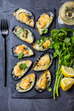 Seafood. Baked mussels with cheese and lemon in shells Stock Photo