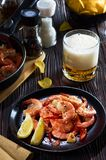 Seafood at the bar, composition of black plate with shrimp lemon beer chips stock photo