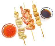 Seafood barbecue with sauce Royalty Free Stock Photo