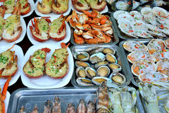 Seafood barbecue. Various seafood as fish and snail, and other raw material in dishes, shown as featured local aroma and different cooking or food culture as Stock Images