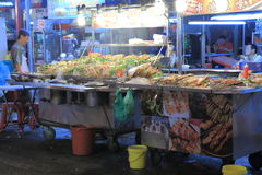 Seafood BBQ restaurant. Local man sells seafood BBQ on Jalan Alor Bukit Bintang in Kuala Lumpur Malaysia Stock Photo