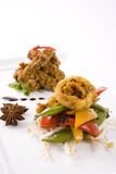 Seafood and Beef. Thai influenced battered Squid rings with pepper and sugar snap pea and beansprout salad, with Crispy Sesame Beef in the background Stock Photo