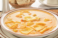 Seafood Bisque with lobster ravioli Royalty Free Stock Photography