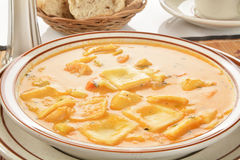 Seafood Bisque with lobster ravioli Stock Photo