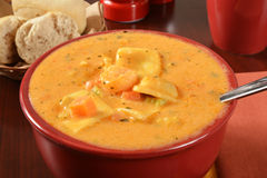 Seafood bisque with ravioli Stock Photo