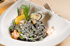 Seafood black spaghetti Stock Images