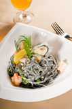Seafood black spaghetti Stock Photos