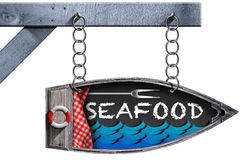 Seafood - Boat Directional Sign with Chain. Directional sign in the shape of row boat with text Seafood. Hanging from a metal chain, isolated on white Stock Images