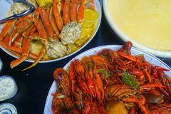 Seafood Boil. Louisiana spicy seafood boil with crab legs and crawfish mudbugs Royalty Free Stock Image