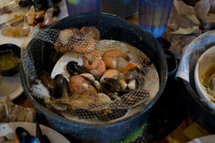 Seafood boil with seasoning. Shrimp, mussels, clams, with seasoning in a pot boiled for eating royalty free stock photos