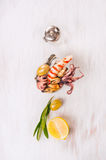 Seafood in bowl with lemon and olives on white wooden background Stock Photography