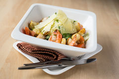 Seafood Caesar salad with roasted shrimps, fresh salad leaves Stock Photography