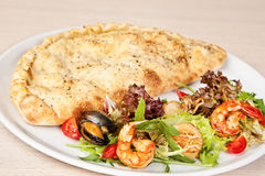 Seafood calzone Royalty Free Stock Photo