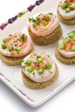Seafood canapes on a square dish. Over white background royalty free stock images