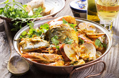 Seafood Cataplana. Portuguese seafood cataplana in traditional pot Stock Image