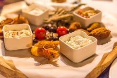 Seafood catering. Fresh Seafood shrimp tzatziki hummus plate royalty free stock photos