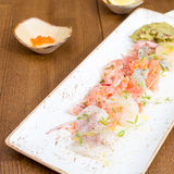 Seafood ceviche. Sea trout, scallops and shrimps with citrus-pickled onions, guacamole and cilantro   on the plate. Shallow DOF Stock Images
