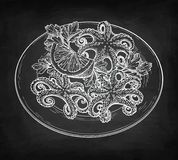 Seafood chalk sketch. Octopuses with lemon on a plate. Seafood chalk sketch on blackboard background. Hand drawn vector illustration. Retro style. Editable Stock Photo