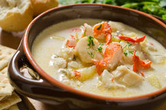 Seafood Chowder. A bowl of fresh seafood chowder with lobster, scallop, halibut, haddock, and clams Stock Image