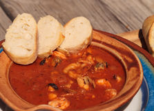 Seafood cioppino with French bread stock image