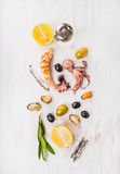 Seafood composing with olives and lemon on white wooden table Stock Images