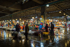 Seafood containers and people at Noryangjin Fish Market in Seoul Stock Photos