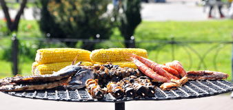 Seafood and corn on grill Royalty Free Stock Photos