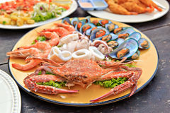 Seafood. Crab, shrimps, squid and molluscs on the plate Stock Photos