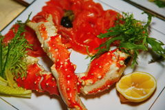 Seafood delicacies. The claws of the Kamchatka sea crab and fillet of red salmon. Royalty Free Stock Photos