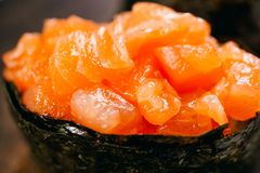 Seafood delicatessen salmon gunkan maki sushi roll. Close up. Delicacy gourmet snacks. Luxury lifestyle, expensive food, restaurant menu royalty free stock photos