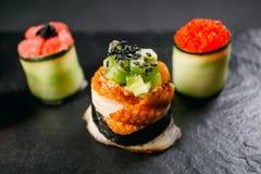 Seafood delicatessen, sushi rolls set on slate stock image