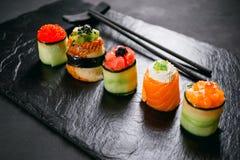 Seafood delicatessen sushi rolls on slate royalty free stock image