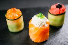 Seafood delicatessen sushi rolls on slate stock image