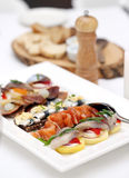 Seafood at a dining table Royalty Free Stock Images