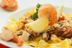 Seafood dinner. Fresh delicious seafood dinner with lemon stock photos