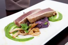 Seafood dinner with fillet of tuna, oyster mushrooms and pea puree Stock Photography