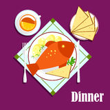 Seafood dinner with fried fish, bread and tea. Seafood dinner with fried fish on plate, with boiled potatoes and spicy herbs, knife and fork, sliced bread and Stock Photos