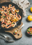 Seafood dinner with grilled tiger prawns in pan, grey background Stock Photo
