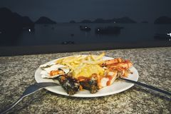 Seafood dinner at restaurant to the sea. Vietnam ha long Bay night, nighttime, tonight stock images