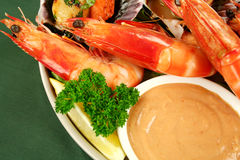 Seafood And Dip. Fresh seafood platter of cooked shrimps and pan fried scallops with coriander with Thousand Island Dressing royalty free stock photography