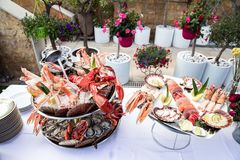 Seafood dish served on restaurant table. Creative restaurant meal concept, haute couture food. Selection of fresh seafood mix. Appetizing seafood platter with Stock Photography