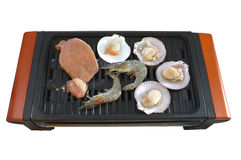 Seafood on enamel grilled stove Stock Image
