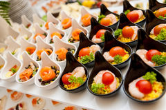 Seafood entree platter. A platter full of ceramic bowls of seafood appetizers Stock Photography